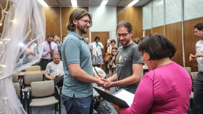 On June 25th, 2014, Craig Bowen (left), Jake Miller (right), become the first gay couple married by Marion County Clery Beth White, at the City County Building in Indianapolis.