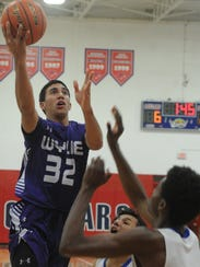 Wylie's Payton Brooks (32) drives to the basket against