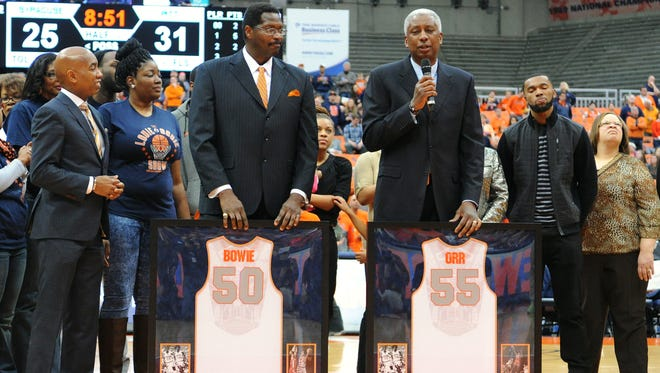 Syracuse Orange alum Louis Orr (right) speaks to the crowd while standing with Roosevelt Bouie during a jersey retirement ceremony at halftime of the game between the Pittsburgh Panthers and the Syracuse Orange at the Carrier Dome in February of 2015.
