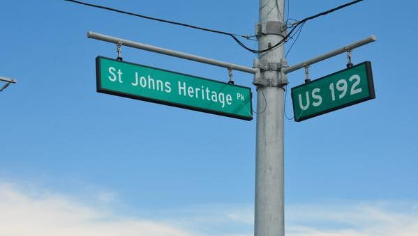 "The opening of the St. Johns Heritage Parkway has been delayed since April due to problems with the stormwater system. ""Road Closed"" signs and orange barrels block off the intersection on U.S. 192 west of Interstate 95."