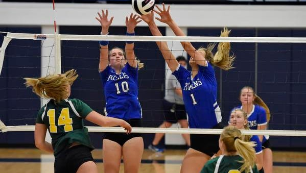 Pickens' Abigail Durham (10) and Sydney Bolding block a shot. Pickens plays Myrtle Beach in the Class AAAA volleyball state championship match Saturday at Chapin High School.