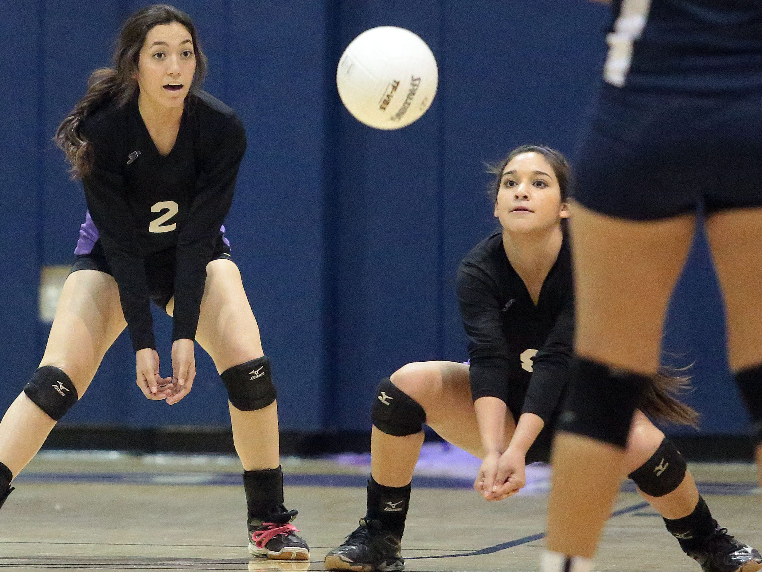 Shadow Hills' Teresa Sandoval (left) and Karla Torres dig against Desert Hot Springs during Wednesday's game. Shadow Hills won 3-0.