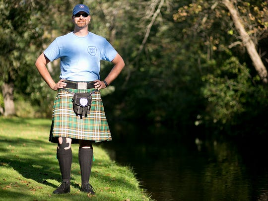 Fred Simons poses with his kilt at Iverson Park in Stevens Point, Thursday, Sept. 10, 2015.