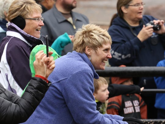 Pam Narvaez of Marshfield reacts as she watches the new bears frolic in their new digs at the Grand Opening Ribbon Cutting & Meet the Cubs ceremony for the new JP Adler Family Kodiak Bear Exhibit at Wildwood Zoo in Marshfield on Saturday.