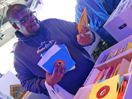 Tarik Thornton, who traveled from New Orleans to attend the Central Mississippi Record Convention, looks for some blues records.