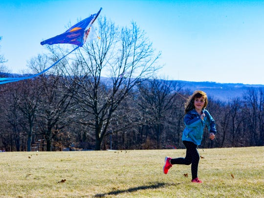 Olivia George, 5 of Springettsbury, flies her kite at Samuel S. Lewis State Park, Sunday Feb. 28, 2016. John A. Pavoncello photo