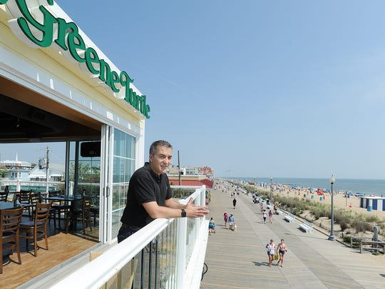 Greene Turtle owner Bill Frankis looks out over the boardwalk at the Rehoboth Beach restaurant.