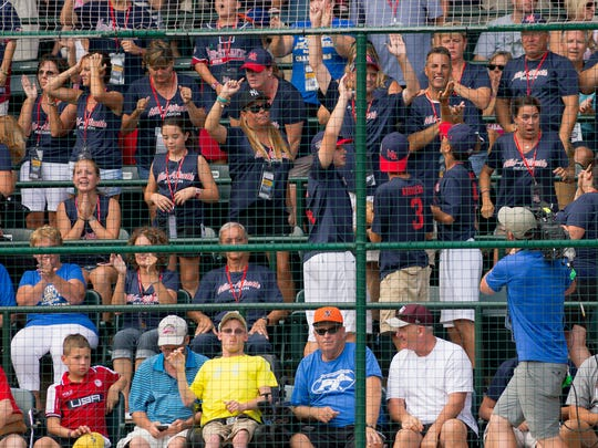 Maine-Endwell Little League parents and family celebrate during the sixth inning of their 2-1 win over East Seoul in the Little League World Series championship game.
