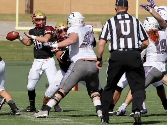 Midwestern State's Layton Rabb passes against Sioux Falls Saturday, Nov. 18, 2017, at Memorial Stadium. The Mustangs defeated the Cougars 24-20 in the first round of the NCAA DII Playoffs.
