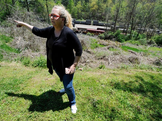"""In this April 12, 2018 photo, Mayor Heather Hall discusses the nearby train that was loaded with tons of sewage sludge that is stinking up her community of Parrish, Ala. More than two months after the so-called """"Poop Train"""" rolled in from New York City, Hall says her small town smells like rotting corpses. Some say the trainloads of New Yorkers' excrement is turning Alabama into a dumping ground for other states' waste."""