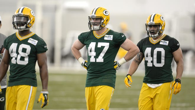 Green Bay Packers rookie Jake Ryan (47) pauses between drills with Joe Thomas (48) and Uona Kaveinga (40) during rookie orientation in the Don Hutson Center May 8, 2015.