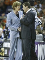 Lady Vols coach Pat Summitt and coach Geno Auriemma of Connecticut meet before the National Championship game of the NCAA Women's Final Four Tournament at the New Orleans Arena on April 6, 2004, in New Orleans, Louisiana.
