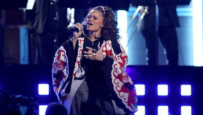 Andra Day performs a tribute to the Bee Gees at the 59th annual Grammy Awards on Sunday, Feb. 12, 2017, in Los Angeles.