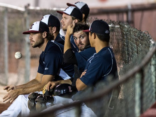 Shane Weedman (left to right) watches his teammates play the Florence Freedom, another Frontier League team from Florence, Ky., as Taylor Hillson talks with Kolten Yamaguchi at Bosse Field in Evansville, Ind., on Wednesday, Aug. 9, 2017. The Freedom defeated the Otters, 3-0.