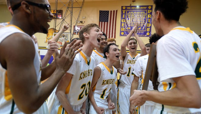 Northeastern celebrates after beating Centerville for the class 2A sectional basketball championship Saturday, March 5, 2016 in Hagerstown.