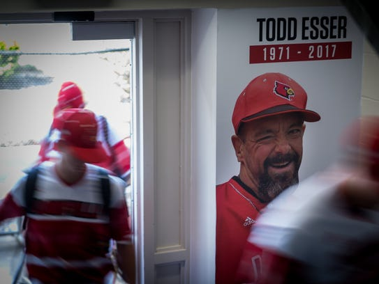 Louisville players head to the clubroom past an images