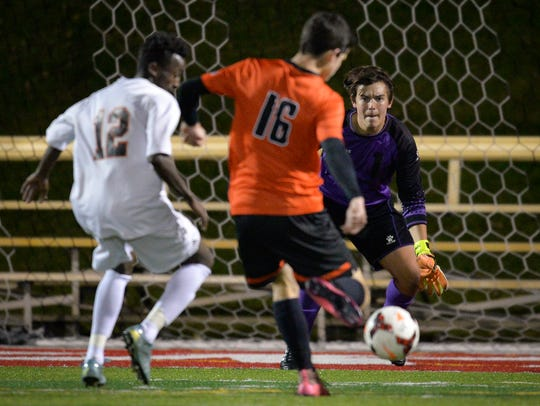 St. Cloud Tech keeper Bryan Helminick (1) watches Moorhead's