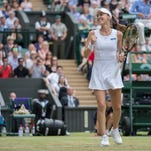 Martina Hingis piles up Grand Slam titles, stays focused on being part of a team