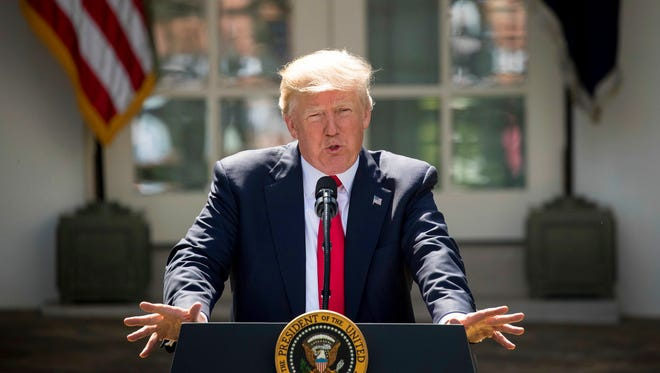 President Donald Trump speaks about the U.S. role in the Paris climate change accord June 1, 2017, in the Rose Garden of the White House.