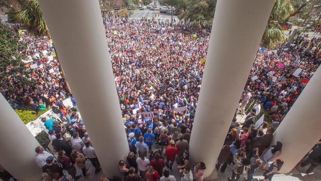 Protesters rally against gun violence on the steps of the old Florida Capitol in Tallahassee, Fla., Wednesday, Feb 21, 2018. Students at schools across Broward and Miami-Dade counties in South Florida planned short walkouts Wednesday, the one week anniversary of the deadly shooting at Marjory Stoneman Douglas High School.