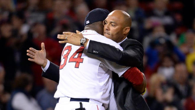 Mariano Rivera and David Ortiz share a hug before Game 2 of the World Series.