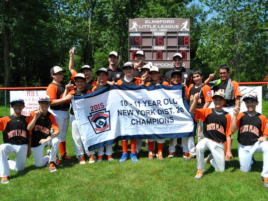 635729302433110053-White-Plains-10-11-baseball-team-won-the-District-20-title-Sunday-at-Piccoli-Field-in-Elmsford