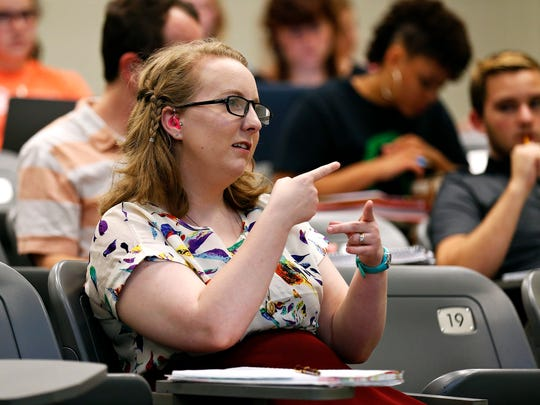 Bethany Hornbeck sits in the front row of her class, as her interpreter signs the words of  the professor at Hill Hall on Missouri State University's campus on Sept. 21, 2016.