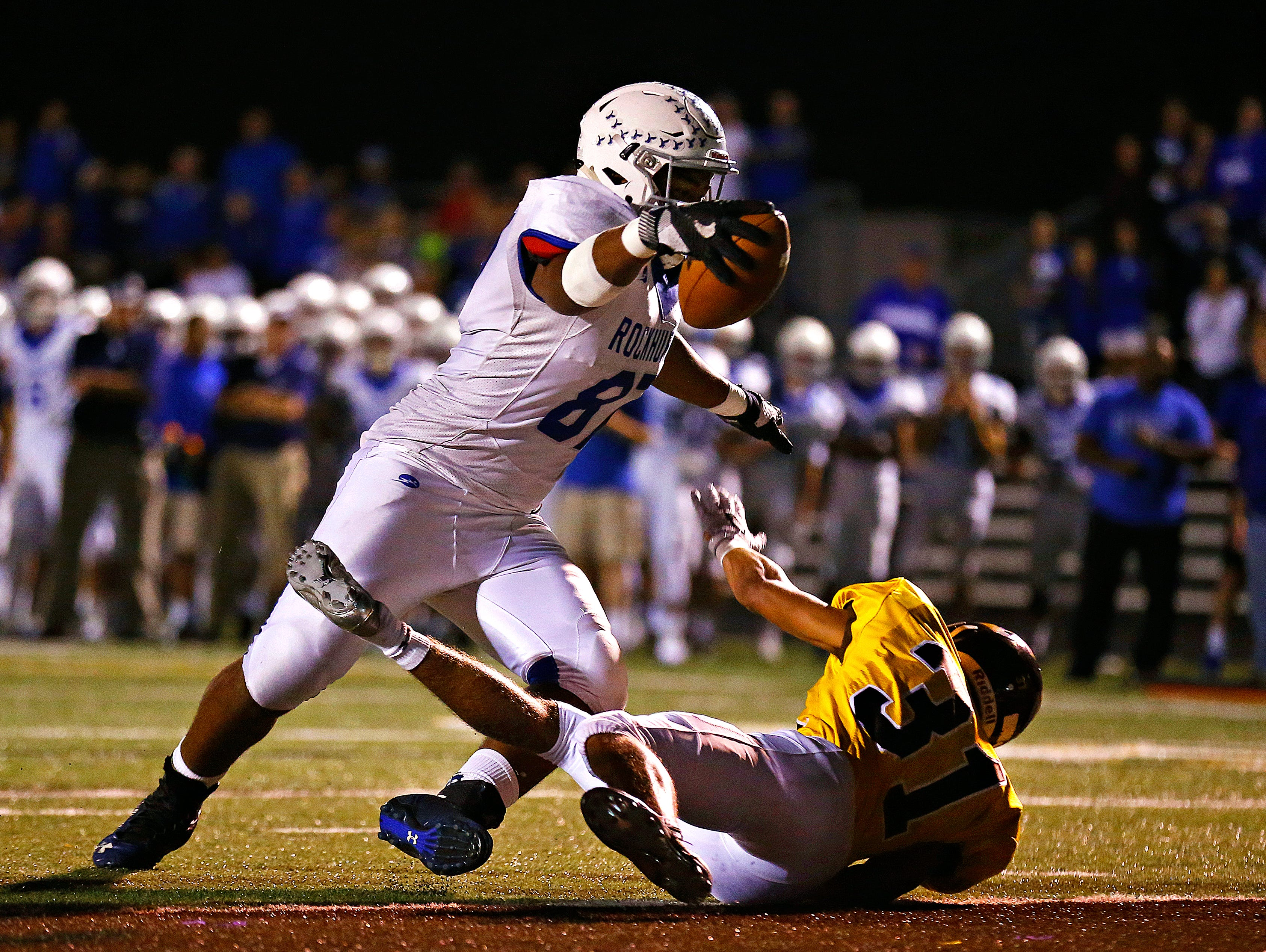 Rockhurst High School tight end Jacob Sykes (87) stretches out over Chiefs defensive back Jabin Johnson (31) to score a touchdown during second quarter action of the Class 6 playoff game between Rockhurst High School and Kickapoo High School played at Pottenger Stadium in Springfield, Mo. on Oct. 28, 2016.
