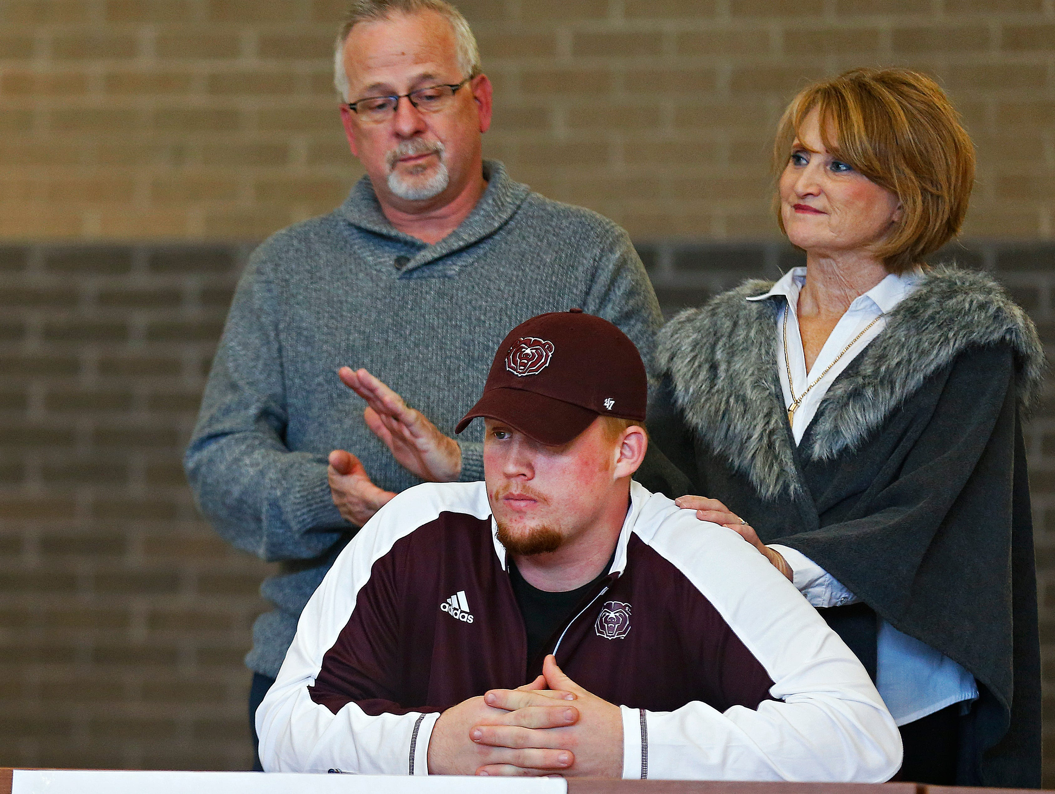 Grant Martin and his family take part in a National Signing Day ceremony held at Kickapoo High School in Springfield, Mo. on Feb. 1, 2017.