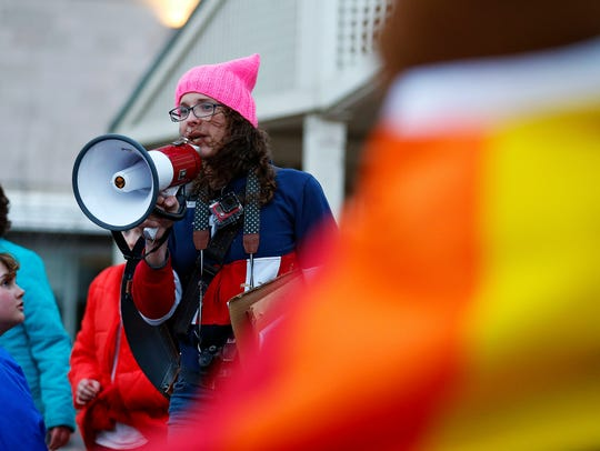 Bethany Johnson addresses attendees during a rally