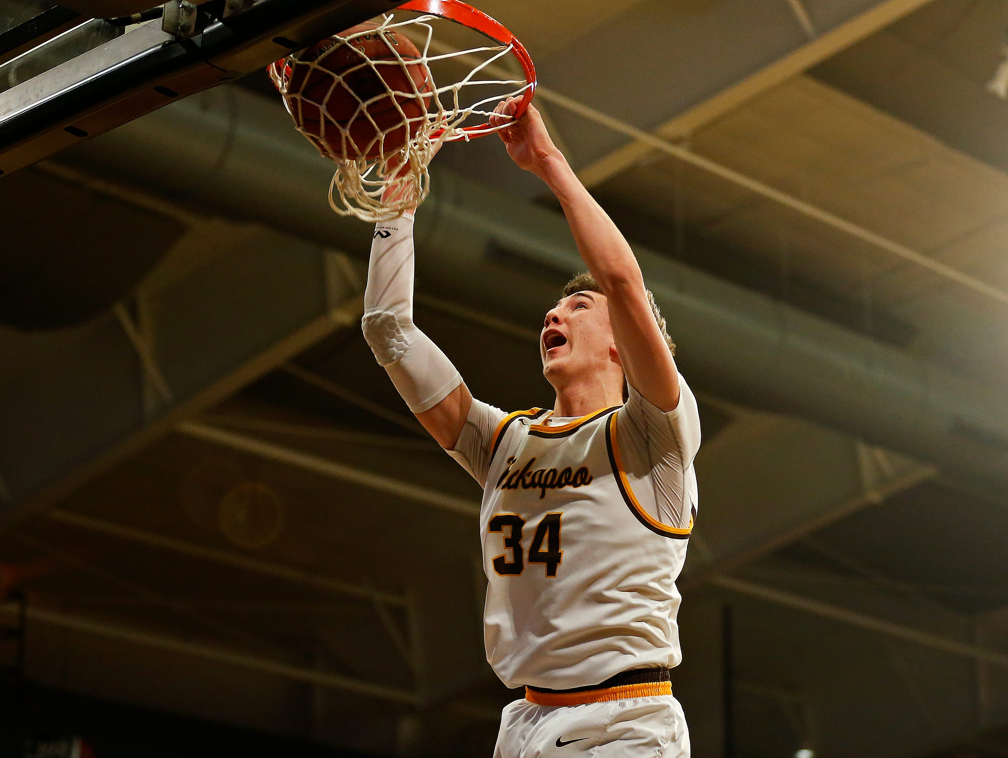Kickapoo Chiefs forward Jared Ridder (34) dunks the ball during first quarter action of the MSHSAA Class 5 sectional playoff game between the Kickapoo High School Chiefs and the Nixa High School Eagles at the O'Reilly Family Event Center in Springfield, Mo. on March 8, 2017. The Kickapoo Chiefs won the game 79-46.