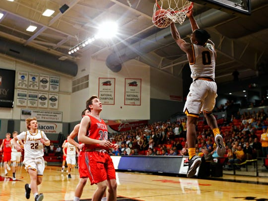Kickapoo Chiefs guard Donyae McCaskill (0) dunks the