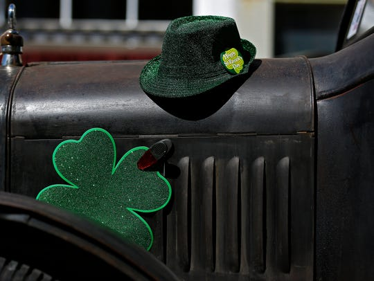 Green decorations affixed to a classic car during the