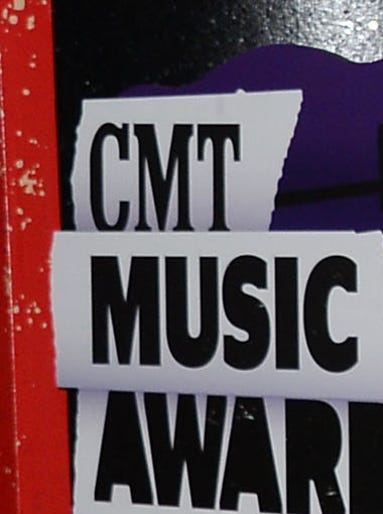 Carrie Underwood and  Mike Fisher attend the 2013 CMT Music  Awards.