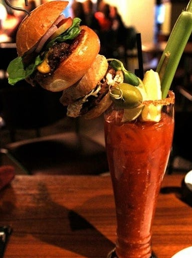 """In Telluride, Colo., the Hotel Madeline's Smak Bar last summer introduced the """"Smak Bloody Mary,"""" which costs $15 for 24 oz. It contains beef stock, as well as cheeseburger sliders, three stuffed olives and more."""