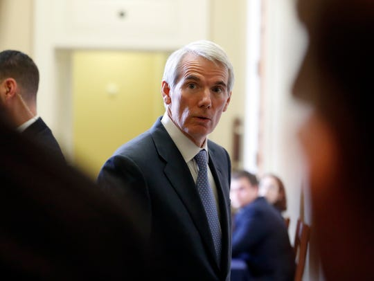 Sen. Rob Portman, R-Ohio, listens to a reporter's question
