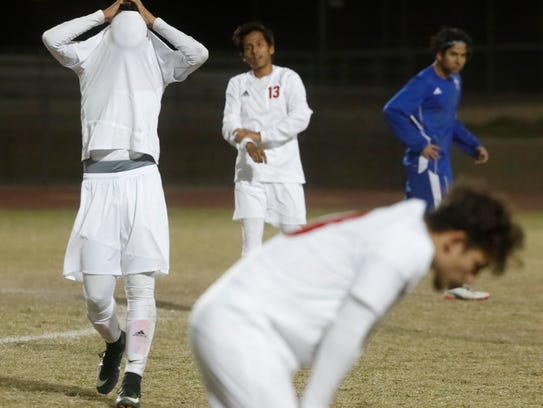 Palm Desert High School's players react after their