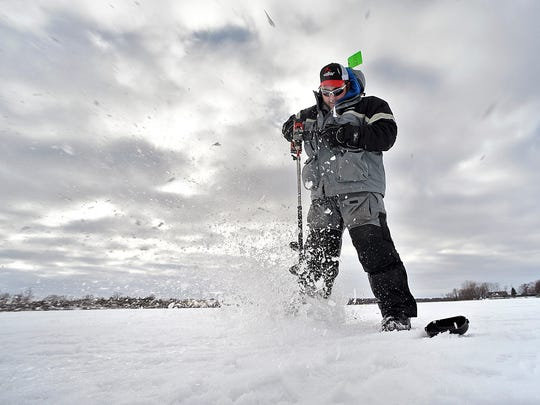Grant Hopke, St. Augusta, drills holes in the ice looking for fish Wednesday, Jan 27 on Beaver Lake. Hopke and his partner Keenan Hemming are competing in the North American Ice Fishing Circuit tournament in February on Lake Mille Lacs.