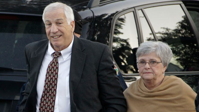 Gormer Penn State assistant football coach Jerry Sandusky arrives with his wife, Dottie Sandusky, for a preliminary hearing at the Centre County Courthouse in Bellefonte, Pa.. on Dec. 13, 2011.