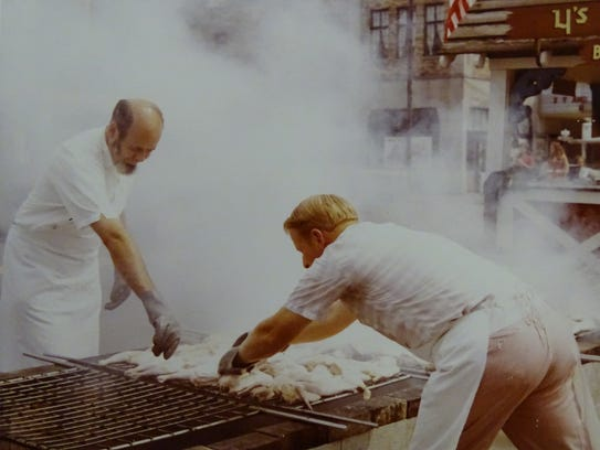 Men grill chicken quarters during the 1968 Bucyrus