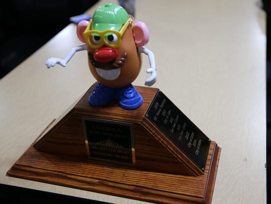 The Mr. Potato Head trophy sits on a table Wednesday at the ECHO Food Bank in Farmington.