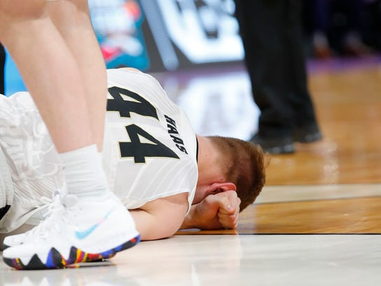 Boilermakers center Isaac Haas (44) lays on the ground