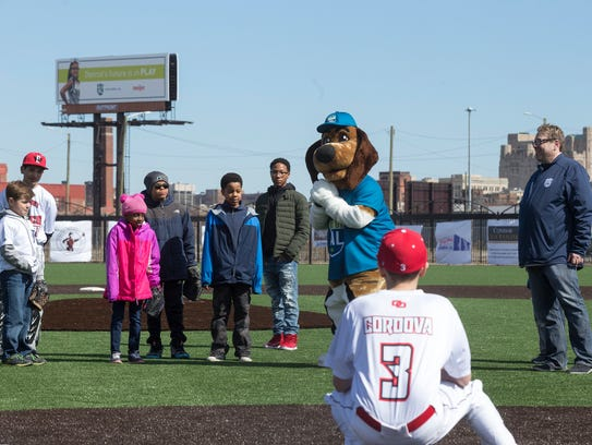 The PAL mascot gets ready to toss a ceremonial pitch