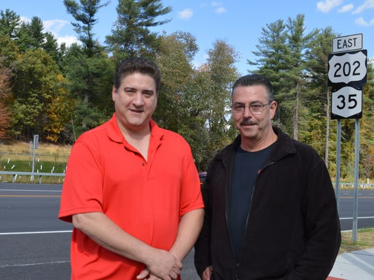 Anthony Caronia, right, owner of ASC Auto Care on Route 202/35 in Yorktown, standing with his customer, Mario Leone, says that traffic moves much better by his shop, now that the road was expanded to five lanes .