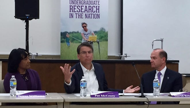 Teresa Williams, chairman of the board at Western Carolina University, and Chancellor David Belcher listen to Gov. Pat McCrory at WCU Friday.