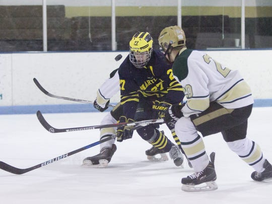 Hartland's Josh Albring (27) was in the running for Mr. Hockey last season, an honor that went to rival Jake Crespi of Brighton.