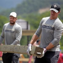 Saints GM Mickey Loomis helps gut a home Wednesday after the June flooding in White Sulphur Springs, W.Va.