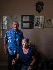 Luis Chirichigno and Diane Megargle in his home in North Naples on Friday, Nov. 3, 2017. Megargle purchased a MIA bracelet in the 1970s for a serviceman who went missing during the Vietnam War. That serviceman was Chirichigno.