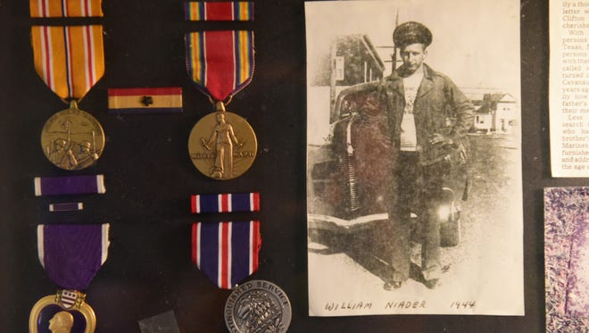 A display for memorabilia William Naider who was killed in Okinawa while serving in the Marines during World War II, hangs in the home of his brother Frank Naider.