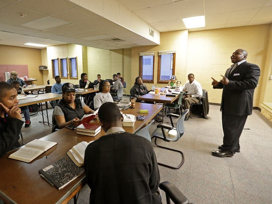 The Rev. Alvin Dupree of Family First Ministries leads a Bible study group at the Appleton church.